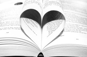 Open book on spine with middle pages curved to form a heart