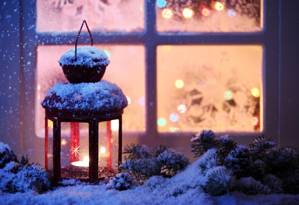 bigstock-Christmas-lantern-with-snowfal-38966599