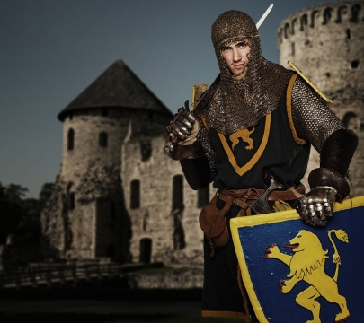 bigstock-Knight-against-medieval-castle-28863290