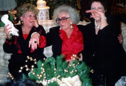 My mom (center) and her sisters. This is how I remember her -- always the life of the party.