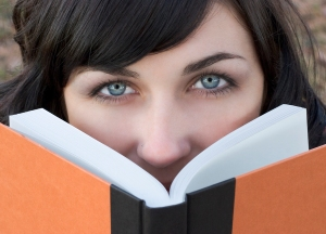 Close up of woman reading book