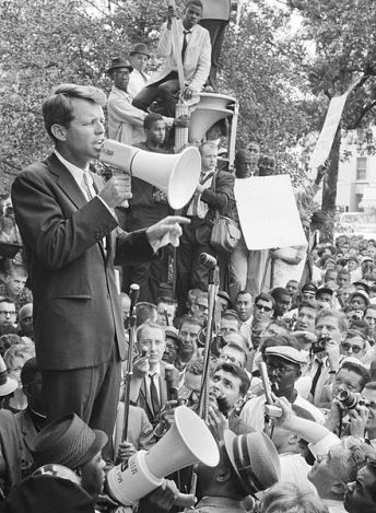 Robert Kennedy with megaphone, addressing a crowd of supporters