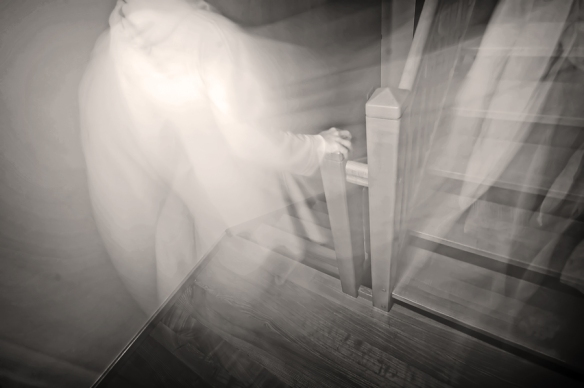 Ghostly figure descending steps