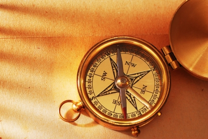 bigstock-Antique-brass-compass-over-old-14767397