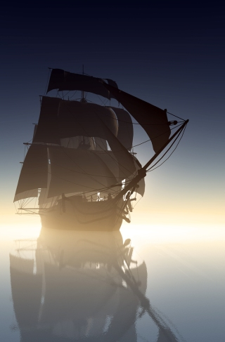 Old sailing ship on a misty sea