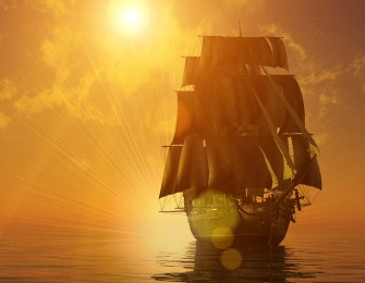 Old sailing ship at dawn