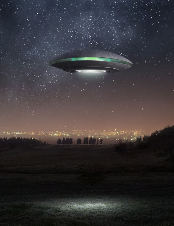 A UFO hovering above a field