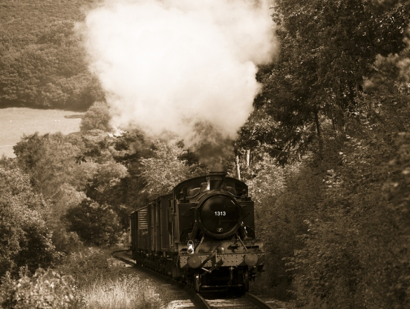 steam train with smoke exiting funnel rising up hill ** Note: Slight blurriness, best at smaller sizes