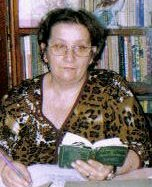 Author Carmen Stefanescu holding an open book