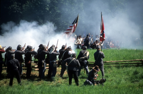 Confederate soldiers advance Civil War battle reenactment