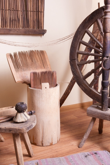 A spinning wheel in an old cottage