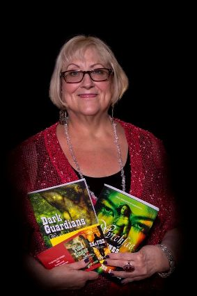 Author , Flossie Benton Rogers, holding  several of her Wytchfae Series novels