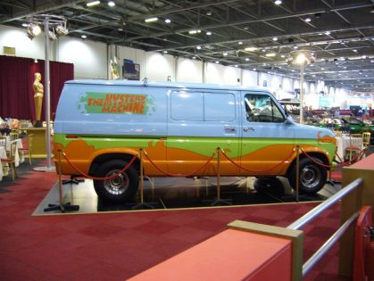 A picture of the Mystery Machine (from Scooby-Doo) from a car show