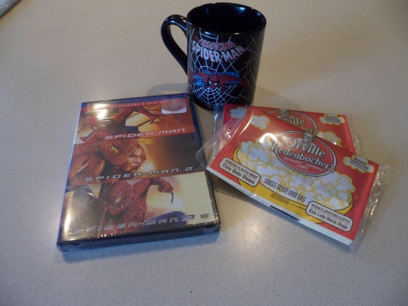 Photo of a Spiderman DVD, with a coffee mug and popcorn pack