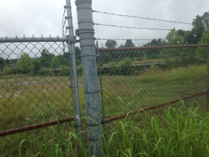 Metal fencing in front of the site of the old North Power Plant in the TNT area, West Virginia
