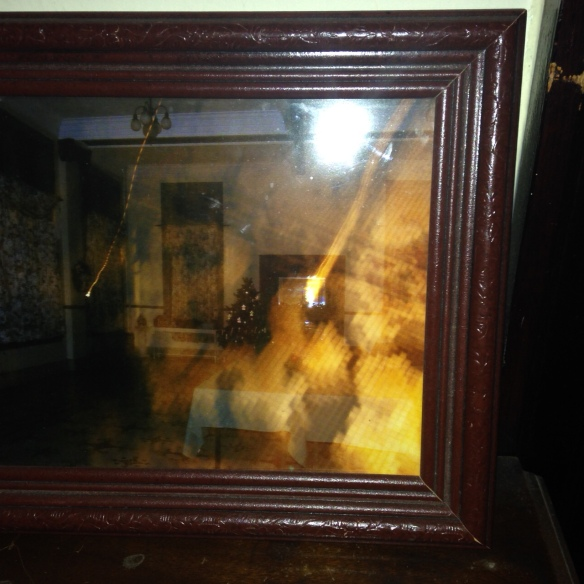 Framed photo of ghost rumored to haunt the Lowe Hotel in West Virginia, apparition visible on right