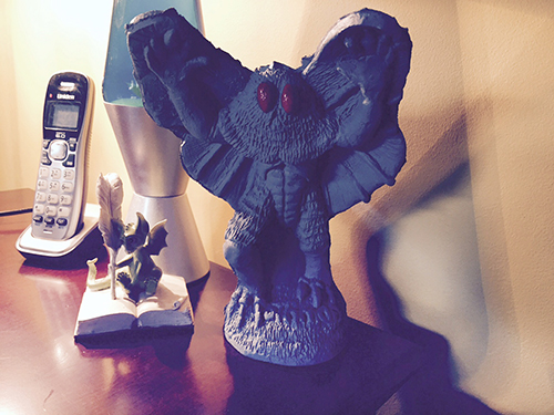 Photo of a desk-sized Mothman statue