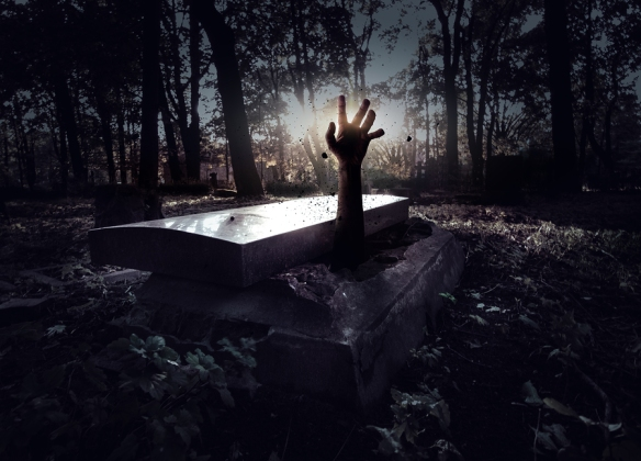 Spooky setting with hand rising out from the grave. Halloween