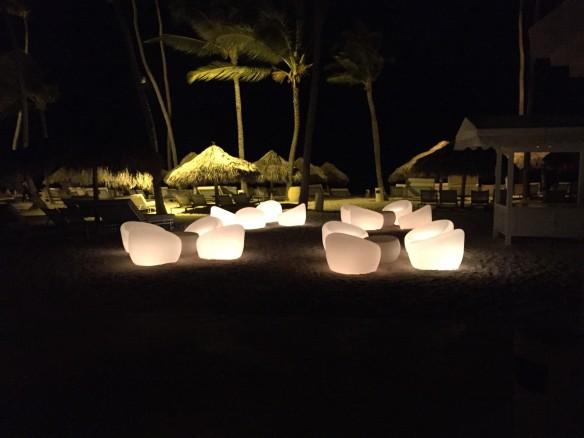 Grouping of beach chairs, lighted from within, at night