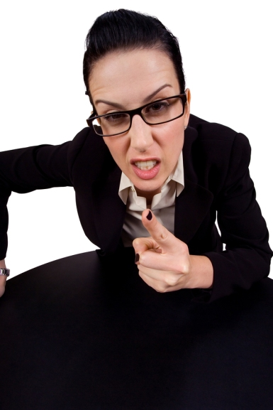 female holding up finger arguing wearing glasses