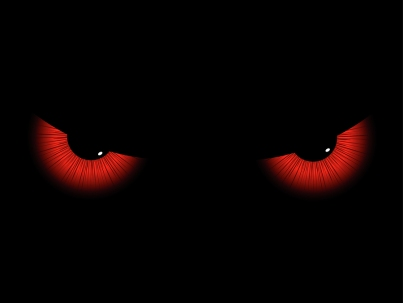 A pair of red evil eyes staring out from a black background