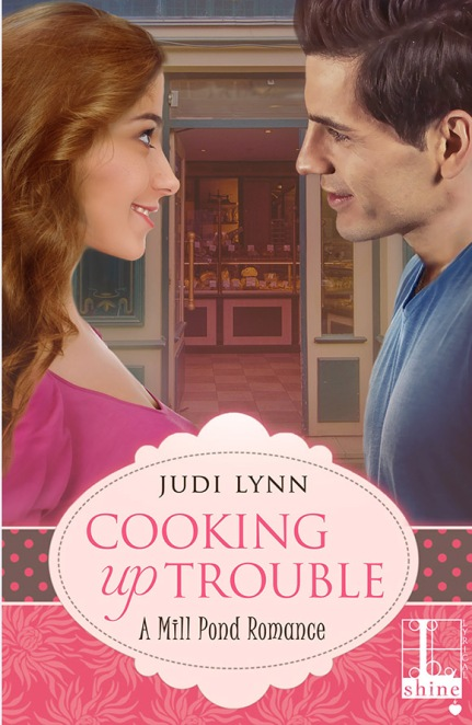 Book cover for Cooking Up Trouble by author Judi Lynn shows an attractive young couple facing each other in front of an open doorway