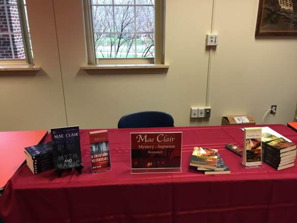 Table display for author book signing by Mae Clair