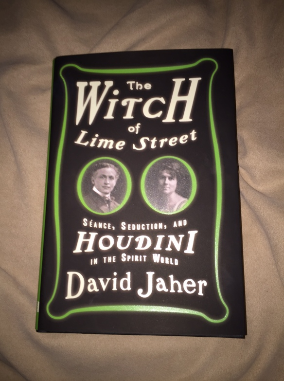 Book cover for the Witch of Lime Street by David Jaher is black with lime green border and cameo photos of Harry Houdini and Margery Crandon