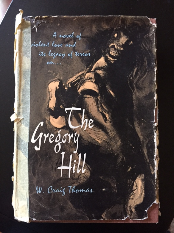Front cover of an old book held together with masking tape on the spine...The Gregory Hill by W. Craig Thomas