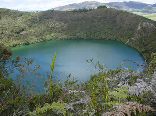 A blue green lake surrounded by mountains
