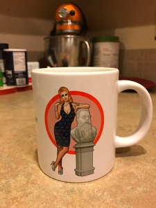 Coffee mug with character and author bust