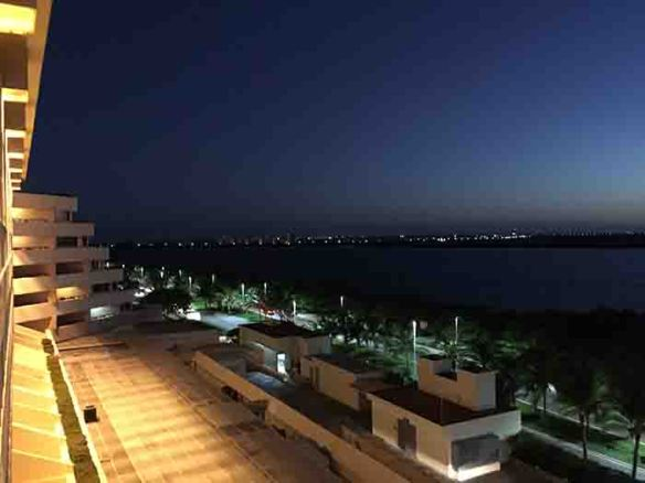 Night time view from a hotel balcony overlooking bay