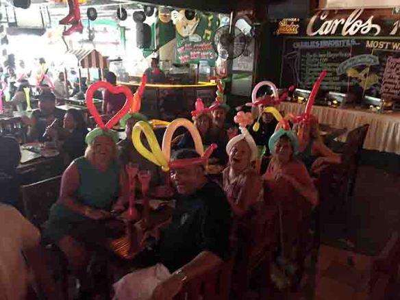 Wearing balloon hats and Carlos' n Charlie's