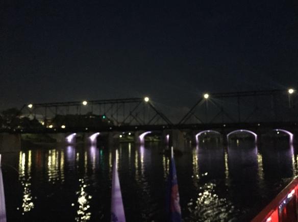 walking bridge over river at night