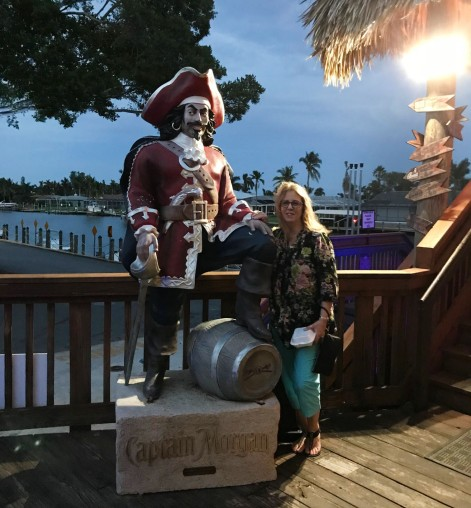 With a large statue of Captain Morgan outside of the Yacht Club restaurant in Cape Coral, Florida
