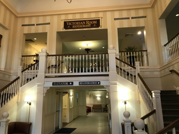 a hotel entrance with a split staircase