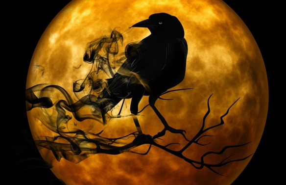 spooky raven on tree branch with full orange moon in the background