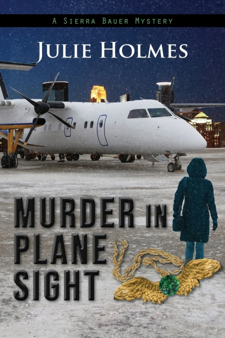 Book cover for Murder in Plane Sight by Julie Holmes shows plane on snowy taxi way with woman in foreground, back to camera