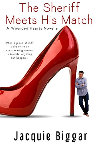 Book cover for The Sheriff Meets His Match by Jacquie Biggar shows man huge red stiletto high heeled shoe with man in jeans and untucked shirt leaning against heel, with arms crossed