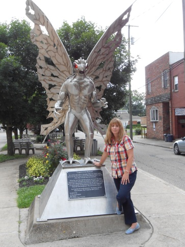 Author, Mae Clair, beside the Mothman statue in Point Pleasant, West Virginia, June 2013