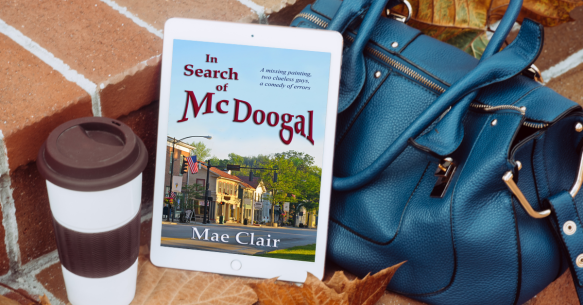 Coffee drink cup beside large blue purse with Kindle showing book cover for In Search of McDoogal by Mae Clair in center