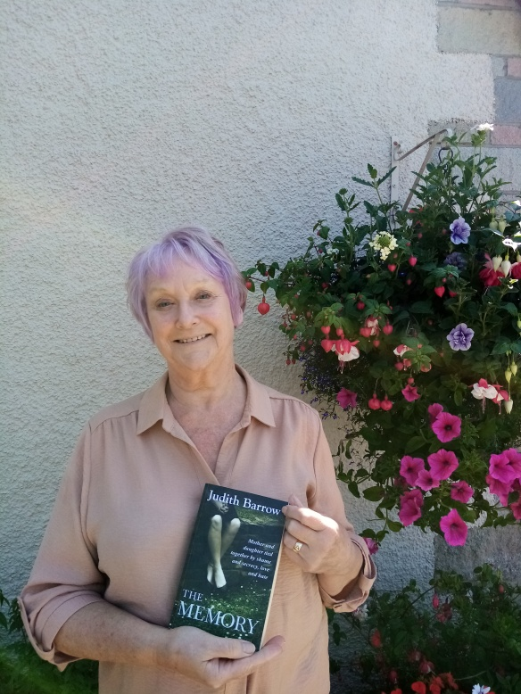 Author Judith Barrow holding her book, The Memory