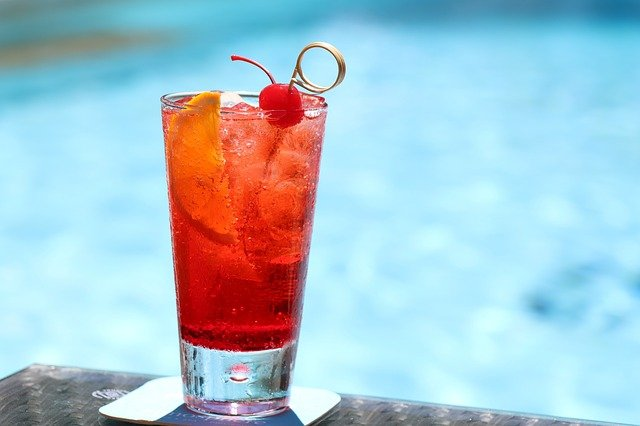 cocktail with pool water in the background