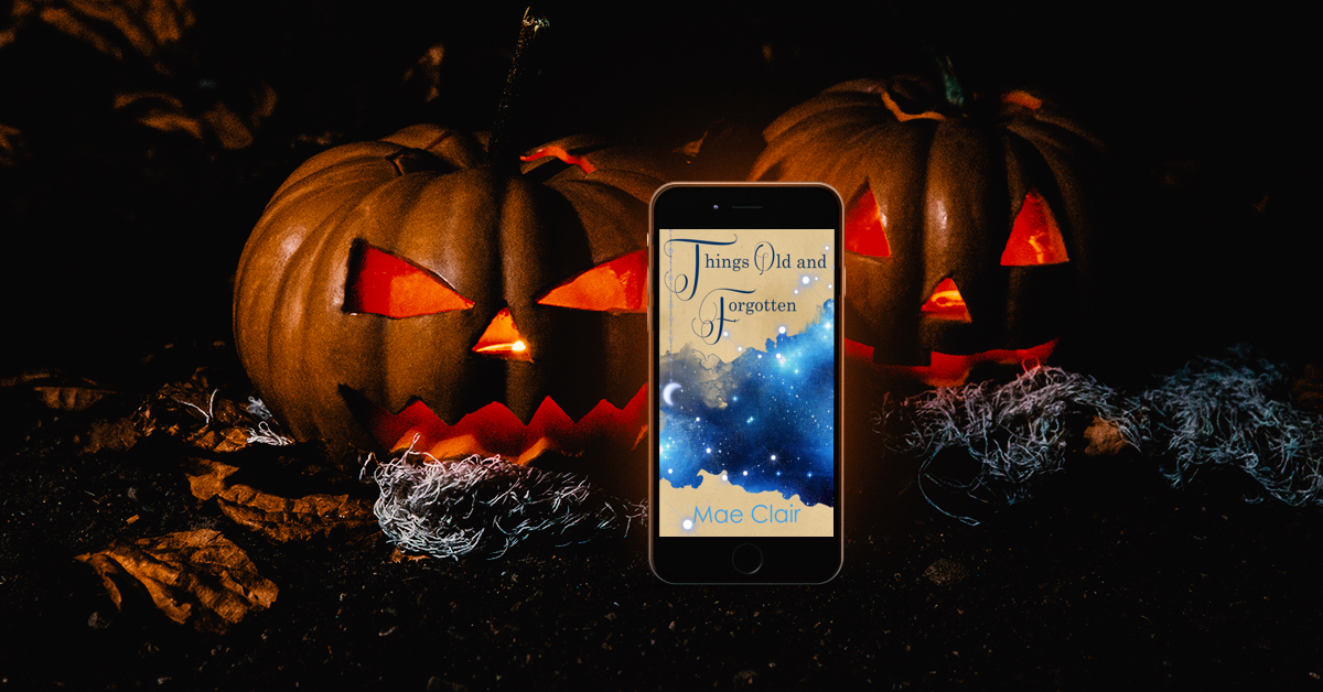 glowing jack-o-lanterns behind mobile phone display book cover of Things Old and Forgotten by Mae Clair